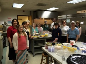 Kitchen crew with Bishop Eaton